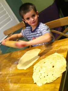 Sage rolling the dough